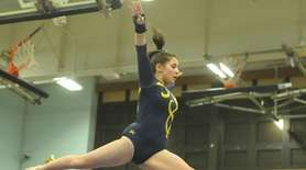 Jenny Mullan of Massapequa performs on the balance