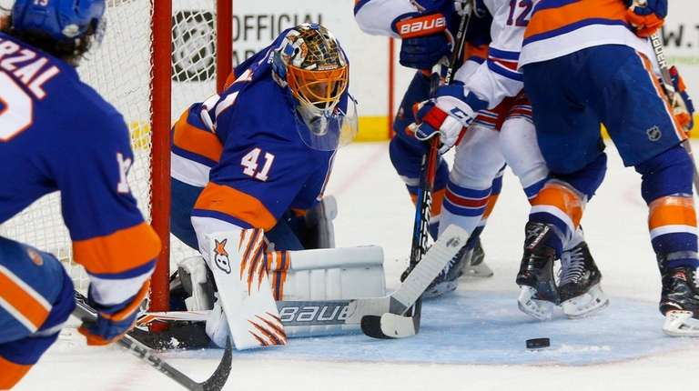 Jaroslav Halak of the Islanders makes a save
