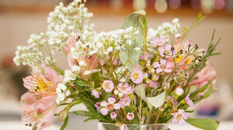 Baby's breath and wax flowers with a couple