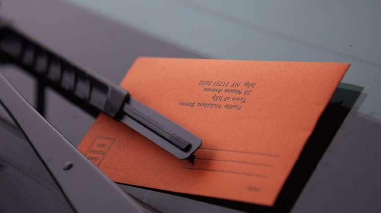 A parking ticket awaits a driver in Bay