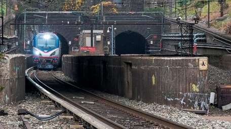 An Amtrak train emerges in North Bergen, N.J.