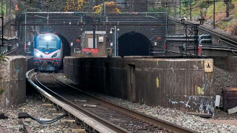 An Amtrak train emerges in North Bergen, N.J.