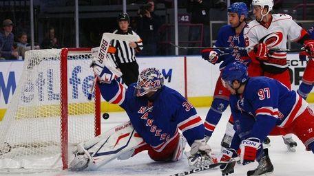 Henrik Lundqvist of the New York Rangers deflects