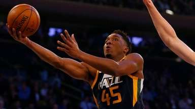 Donovan Mitchell #45 of the Utah Jazz goes