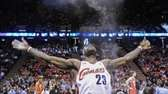 Cleveland Cavaliers' LeBron James throws powder into the