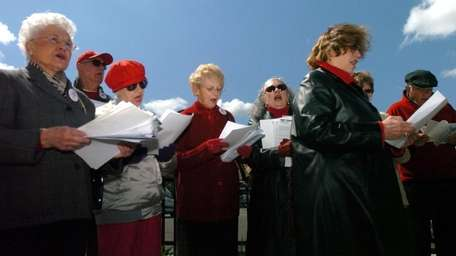 Voice of the Faithful members, sing and pray
