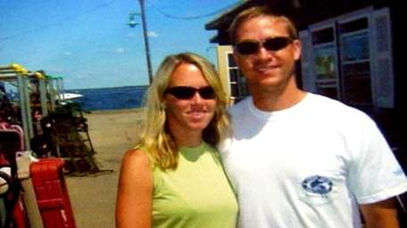 Kristen Bednar of East Patchogue, with her husband