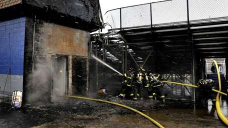 Levittown firefighters battle a suspicious fire that caused