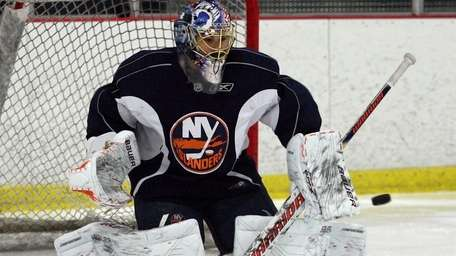 Rick DiPietro practices with Islanders in November. (November