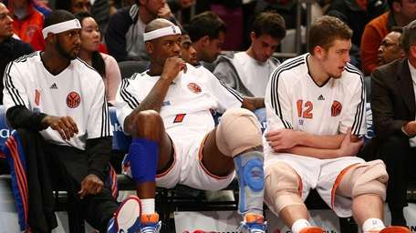 Larry Hughes watches the Knicks' blowout win over