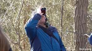 Bird-watchers took a three-mile walk through the William Floyd