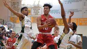 Connetquot's Seth Goumba drives up to the basket