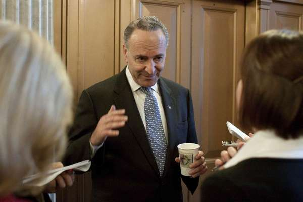 Sen. Chuck Schumer, D-N.Y., talks to reporters on