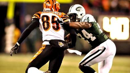 Chad Ochocinco is closely defended by Darell Revis.