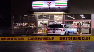 Authorities are investigating the robbery of a 7-Eleven