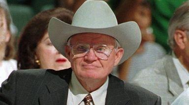Dallas Mavericks owner Don Carter watches his team