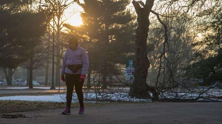 A woman takes an early morning walk through