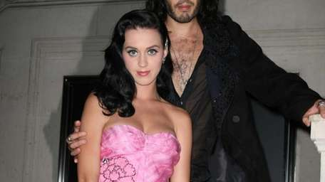 Katy Perry and Russell Brand attend the Louis