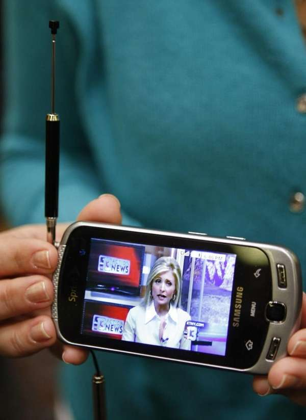 A Samsung cell phone takes in a live