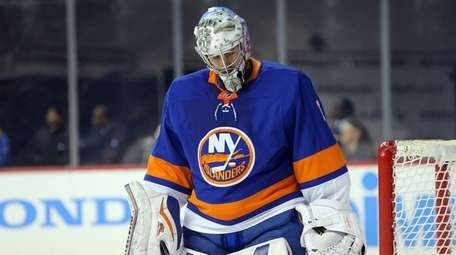 Islanders goalie Thomas Greiss reacts after allowing three