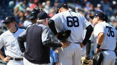 Yankees pitching coach Larry Rothschild speaks with relief