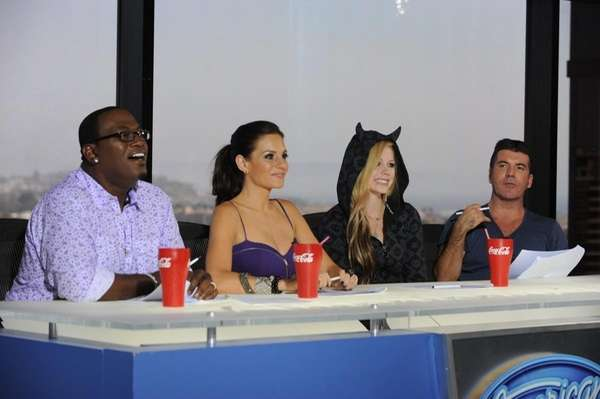 Guest judge Avril Lavigne, second from right, joins