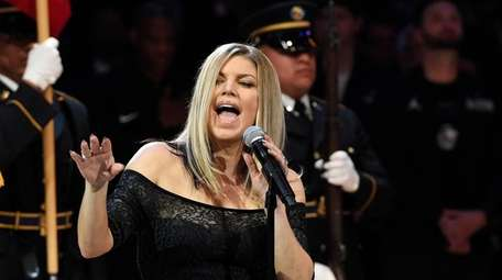 Singer Fergie performs the national anthem before the