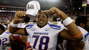 Boise State's Charles Leno celebrates after defeating TCU,