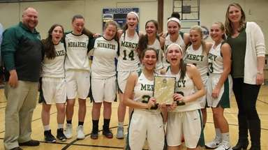 Mercy players celebrate their victory over Stony Brook