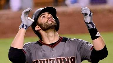 J.D. Martinez of the Diamondbacks celebrates his third