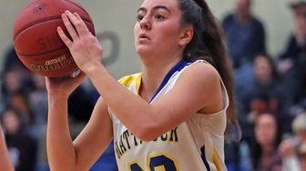 Mattituck's Liz Dwyer hits a three-point basket during