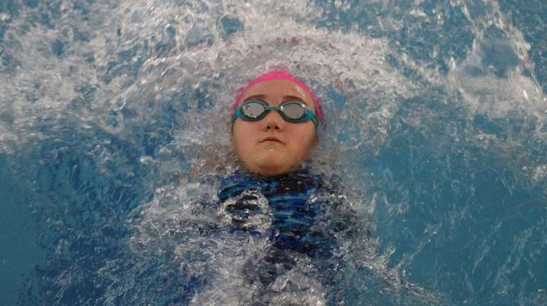 Triton team member Izzy Sartori, 11, practices with