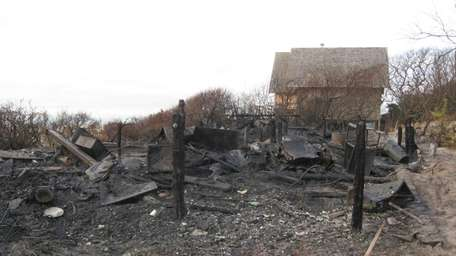 The charred remains of an oceanfront home on