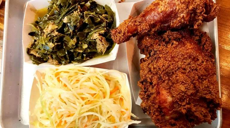 Buttermilk fried chicken is accompanied by collard greens