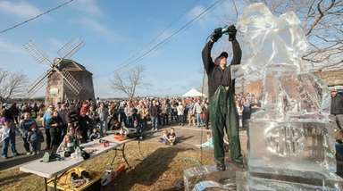 Hundreds of spectators watch an ice sculptor at