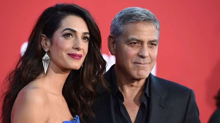 Amal Clooney and George Clooney at the premiere