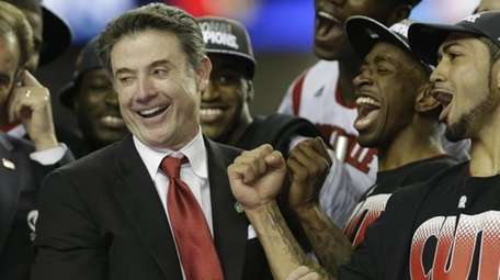 Louisville head coach Rick Pitino reacts with his