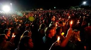Thousands gather at a candlelight vigil last week