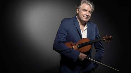 French composer and jazz violinist Didier Lockwood poses