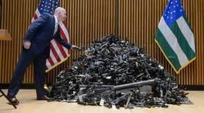 NYPD Commissioner James P. O'Neill tosses a pistol