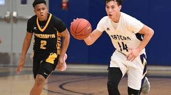 Greenport guard Jordan Fonseca dribbles the ball up