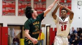 Half Hollow Hills East's Julien Crittendon (10) shoots