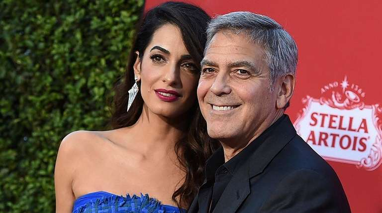 Amal Clooney and George Clooney arrive at the