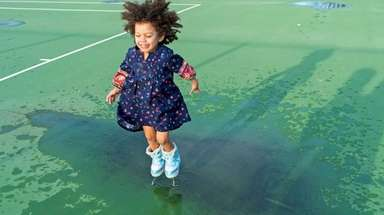 Maleah Scott, 2, of Riverhead splashes in a