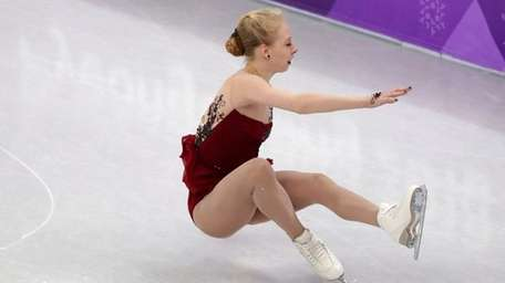 Bradie Tennell of the United States falls during