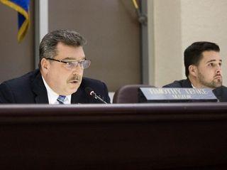 Glen Cove mayor Timothy Tenke votes on the