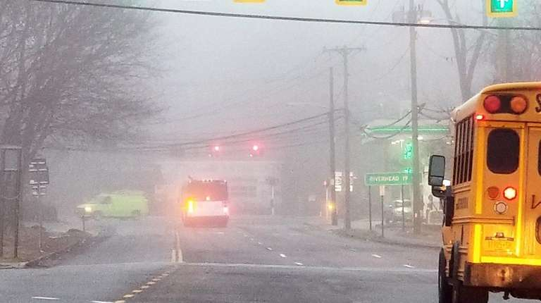 Fog hugs Route 112 as traffic makes its