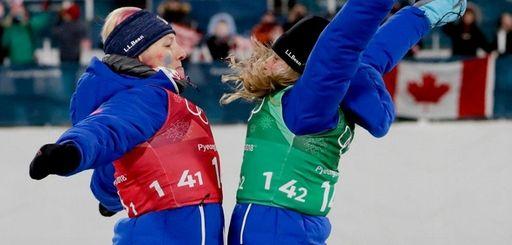USA's Jessica Diggins, right, and Kikkan Randall celebrate