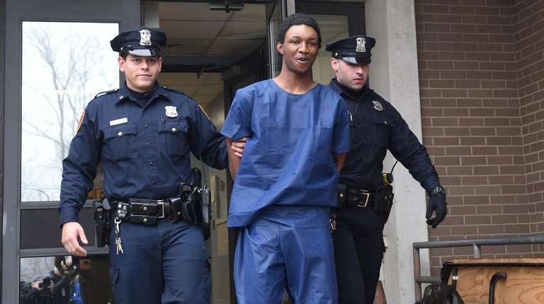 Tayawon Anderson, 20, of Bayport, is led from