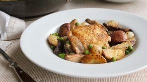 Chicken thighs, shiitake mushrooms, peas and potatoes cook